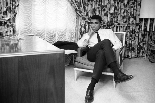 <p>World heavyweight champion Muhammad Ali sits in his room on his arrival in Houston, Feb. 20, 1967. The champ was silent on his thoughts about his draft status referring all questions to his New York attorney. The Houston Selective Service appeals board refused his appeal for a deferment. He was trying for a deferment on grounds that he is a Muslim minister. Ali starts training tomorrow for his title defense against Zora Folley on March 22 in New York. (AP Photo/Ed Kolenovsky)</p>