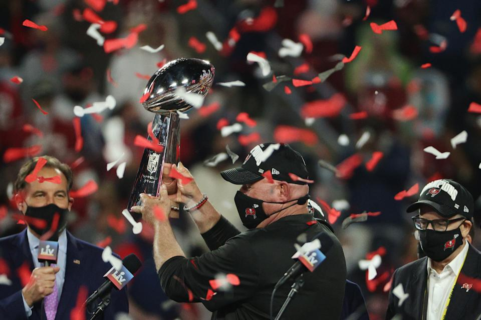 TAMPA, FLORIDA - FEBRUARY 07: Head coach Bruce Arians of the Tampa Bay Buccaneers lifts the Lombardi Trophy after defeating the Kansas City Chiefs in Super Bowl LV at Raymond James Stadium on February 07, 2021 in Tampa, Florida. The Buccaneers defeated the Chiefs 31-9. (Photo by Patrick Smith/Getty Images)