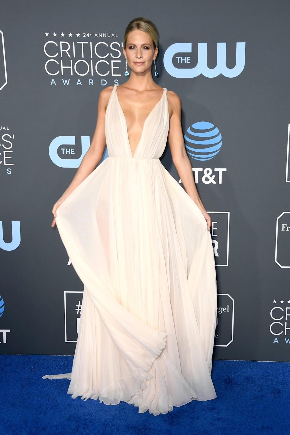 <p>Poppy Delevingne wearing a flowy gown with Kallati earrings and Christian Louboutin heels.</p>