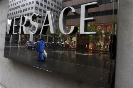 A sign is seen for a high-end retail store along 5th Avenue in New York