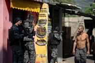 Civil Police officers take part in an operation against alleged drug traffickers at the Jacarezinho favela in Rio de Janeiro, Brazil, on May 06, 2021