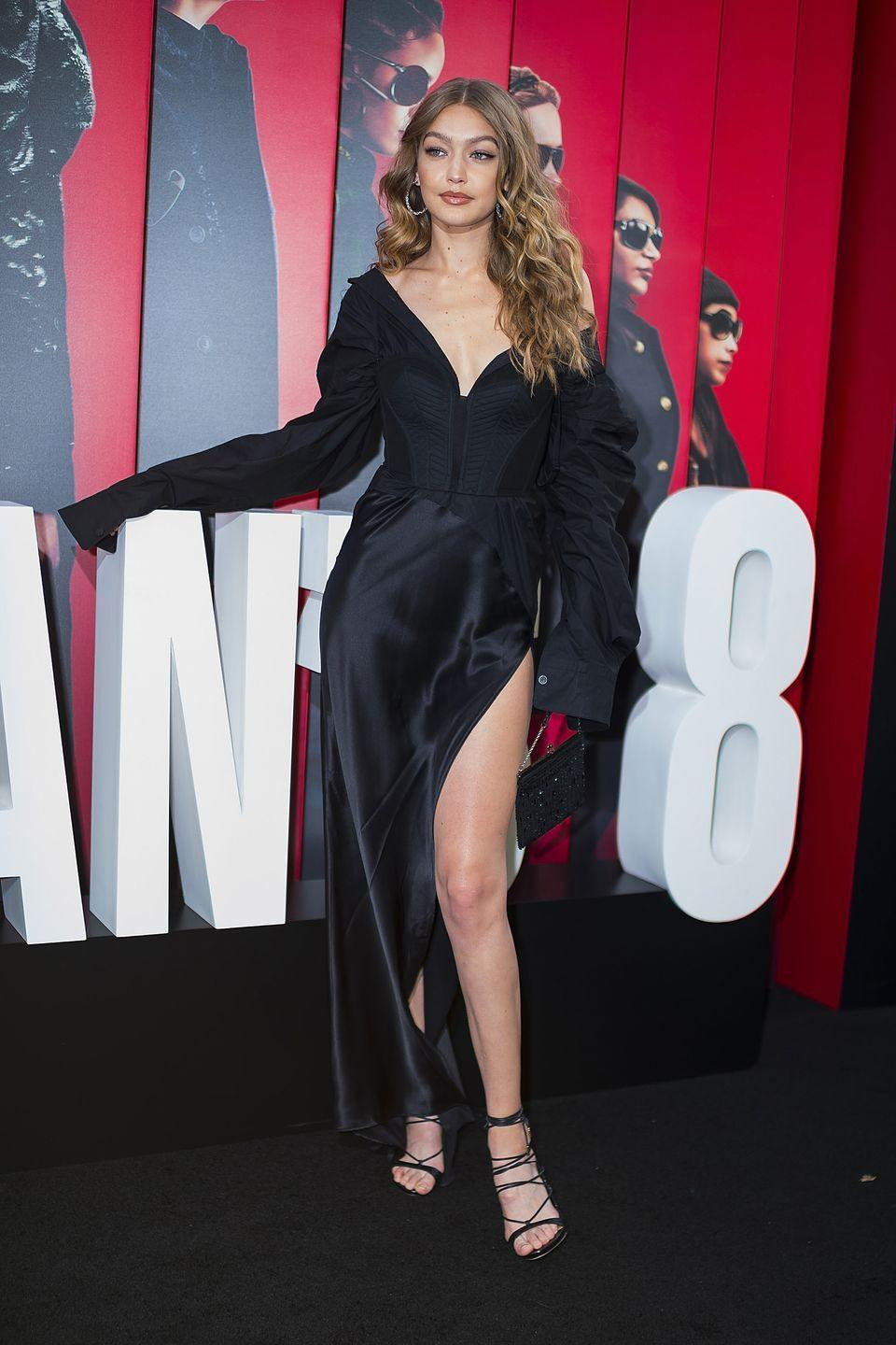 <p>In a Vera Wang black thigh high slit gown walking the red carpet of the New York premiere for <em>Ocean's 8. </em></p>