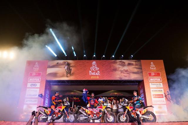 """Podio: #14 Red Bull KTM Factory Racing KTM: Sam Sunderland, #3 Red Bull KTM Factory Racing KTM: Toby Price, #1 Red Bull KTM Factory Racing KTM: Matthias Walkner <span class=""""copyright"""">Red Bull Content Pool</span>"""
