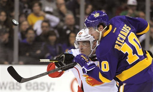 Calgary Flames left wing Mike Cammalleri, left, and Los Angeles Kings center Mike Richards battle for the puck during the third period of their NHL hockey game, Saturday, Feb. 18, 2012, in Los Angeles. The Flames won 1-0. (AP Photo/Mark J. Terrill)