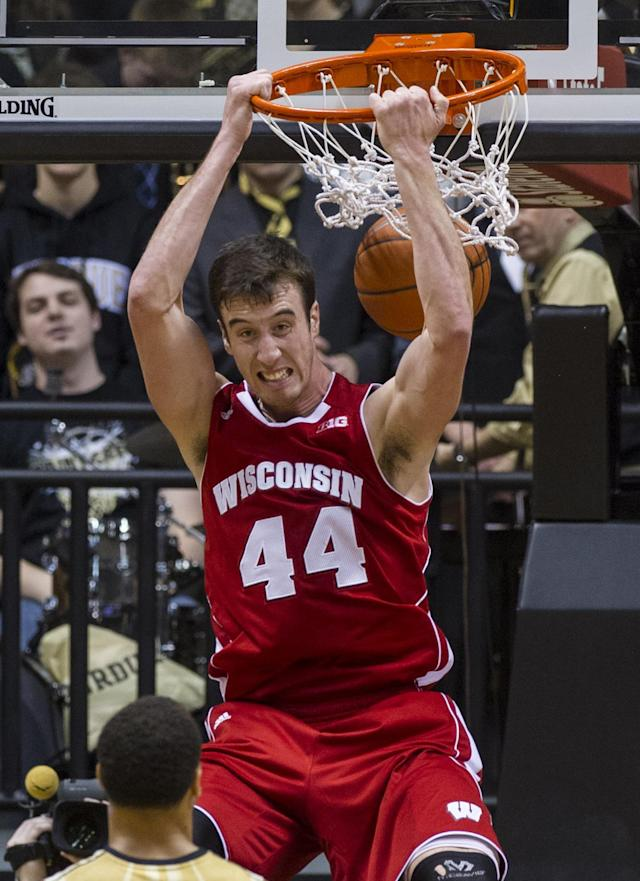 Wisconsin's Frank Kaminsky (44) slam dunks the ball late in the second half of an NCAA college basketball game, Saturday, Jan. 25, 2014, in West Lafayette, Ind. Wisconsin defeated Purdue 72-58. (AP Photo/Doug McSchooler)