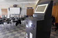 A recently purchased air scrubber stands in a classroom in advance of the school year at the E.N. White School in Holyoke, Mass., on Wednesday, Aug. 4, 2021. Schools across the U.S. are about to start a new year amid a flood of federal money larger than they've ever seen before, an infusion of pandemic relief aid that is four times the amount the U.S. Department of Education sends to K-12 schools in a typical year. (AP Photo/Charles Krupa)