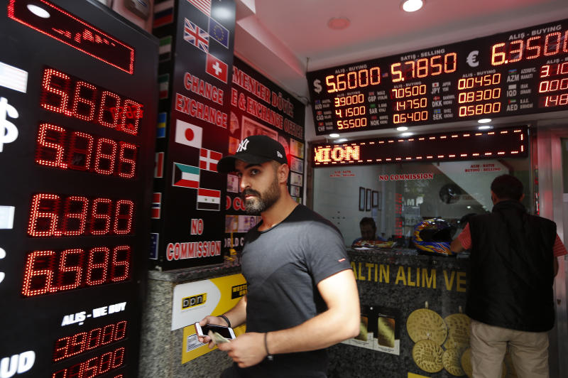 The Latest: Moody's cuts Turkey's credit rating further