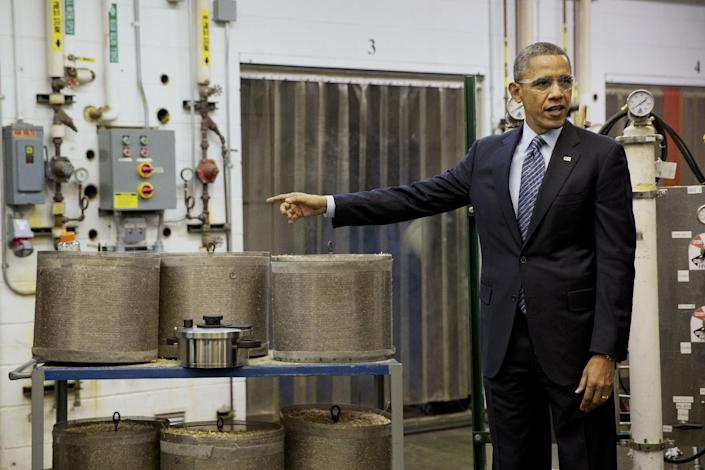 President Barack Obama tours the biomass conversion process area at the Michigan Biotechnology Institute in Lansing, Mich., Friday, Feb. 7, 2014. While in Michigan the president is expected to speak about the farm bill. (AP Photo/Jacquelyn Martin)