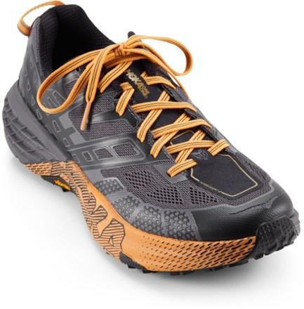 """<p><strong>HOKA ONE ONE</strong></p><p>rei.com</p><p><strong>$110.93</strong></p><p><a href=""""https://www.rei.com/product/117675"""" target=""""_blank"""">Buy Now</a></p><p><a class=""""body-btn-link"""" href=""""https://www.rei.com/product/117672/hoka-one-one-speedgoat-2-trail-running-shoes-womens"""" target=""""_blank"""">Buy Women's</a></p>"""