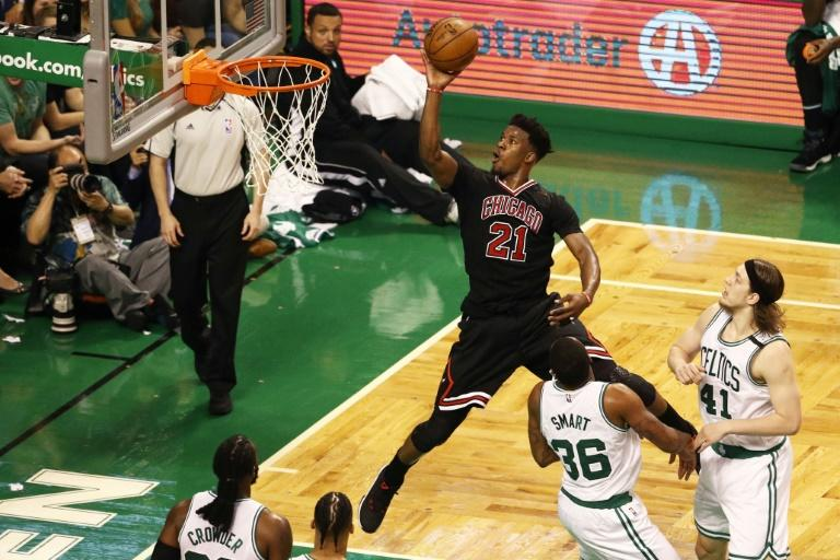 Jimmy Butler of the Chicago Bulls takes a shot against the Boston Celtics during the third quarter of Game One of the Eastern Conference quarter-finals, at TD Garden in Boston, Massachusetts, on April 16, 2017