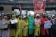 Protesters wear wet weather gear to protect against police water cannon as they take part in a demonstration against the military coup in Yangon on February 9, 2021