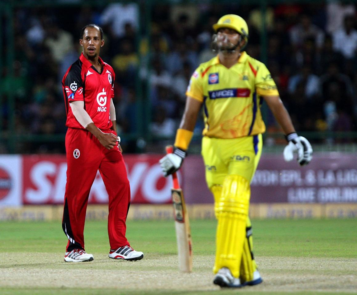 T&T's Lendl Simmons celebrates after taking wicket of Suresh Raina during the CLT20 match between Chennai Super Kings and Trinidad & Tobago at Feroz Shah Kotla, Delhi on Oct. 2, 2013. (Photo: IANS)