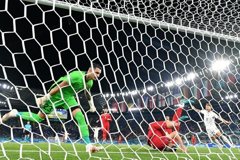 Turkey defender Merih Demiral (2R) lies in a heap after scoring an own goal in the tournament opener against Italy