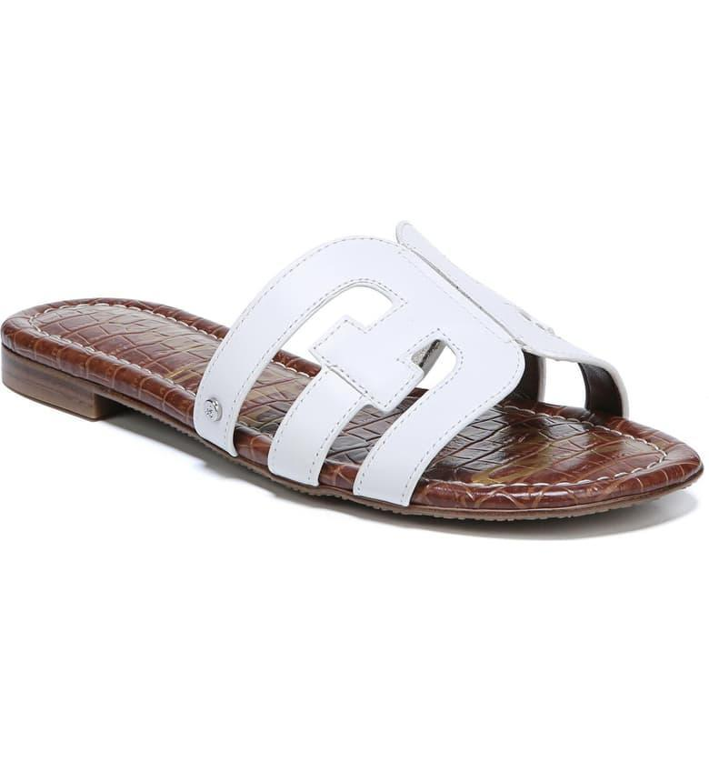 """<h3>Sam Edelman's Bay Cutout Slide Sandal</h3> <br>Sam Edelman's svelte slides are an oft-spotted summer shoe. With a cushioned footbed, low profile, and minimal leather upper, these easy-wearing kicks are a reminder of just how chic a white sandal can be. A Nordstrom customer put it best: """"This sandal is a better alternative to your flip flops. It adds a touch of glam to every casual outfit while being incredibly comfortable."""" (Reviewers also unanimously attest to the style's wide-foot friendliness.)<br><br><strong>Cleaning Hack:</strong> We know you'll be wearing these a lot, so you can remove any scuffs that build up on the sides with some Saddle Soap (a lubricating cleaner designed for leather).<br><br><br><strong>Sam Edelman</strong> Bay Cutout Slide Sandal, $, available at <a href=""""https://go.skimresources.com/?id=30283X879131&url=https%3A%2F%2Fwww.nordstrom.com%2Fs%2Fsam-edelman-bay-cutout-slide-sandal-women%2F4819953"""" rel=""""nofollow noopener"""" target=""""_blank"""" data-ylk=""""slk:Nordstrom"""" class=""""link rapid-noclick-resp"""">Nordstrom</a><br><br><strong>Fiebing's</strong> Saddle Soap, $, available at <a href=""""https://www.amazon.com/Fiebings-FIBSOAP97T005L-Saddle-Soap/dp/B016WVW35A"""" rel=""""nofollow noopener"""" target=""""_blank"""" data-ylk=""""slk:Amazon"""" class=""""link rapid-noclick-resp"""">Amazon</a><br><br><br><br>"""