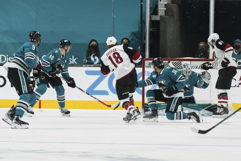 Arizona Coyotes center Christian Dvorak (18) scores a goal against the San Jose Sharks during the first period of an NHL hockey game in San Jose, Calif., Saturday, May 8, 2021. (AP Photo/John Hefti)