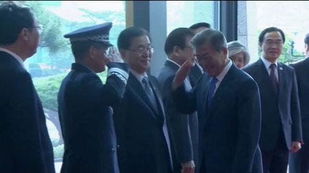 South Korean President Moon Jae-in arrives for the inter-Korean summit at the truce village of Panmunjom, in this still frame taken from video, South Korea April 27, 2018. Host Broadcaster via REUTERS TV