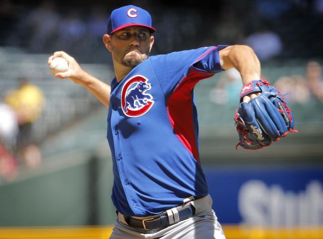 Chicago Cubs pitcher Jason Hammel throws during the first inning of an exhibition spring training baseball game against the Arizona Diamondback, Saturday, March 29, 2014, in Phoenix. (AP Photo/Matt York)