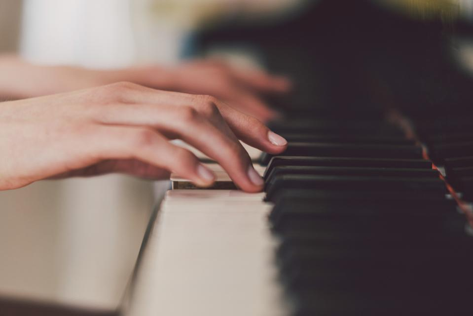 Close up,female hands playing piano.