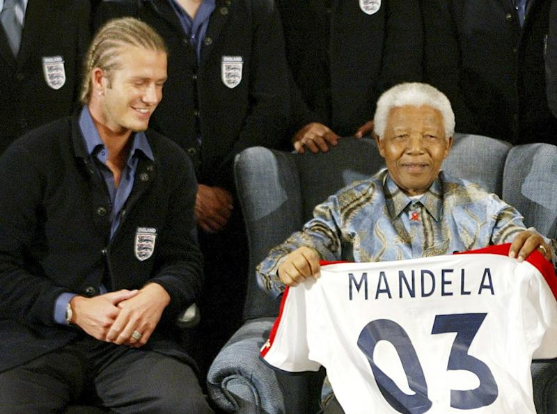 England captain David Beckham poses with former South African president Nelson Mandela on May 21, 2003, at the Nelson Mandela Foundation in Houghton, Johannesburg, South Africa. Photo by Getty Images.