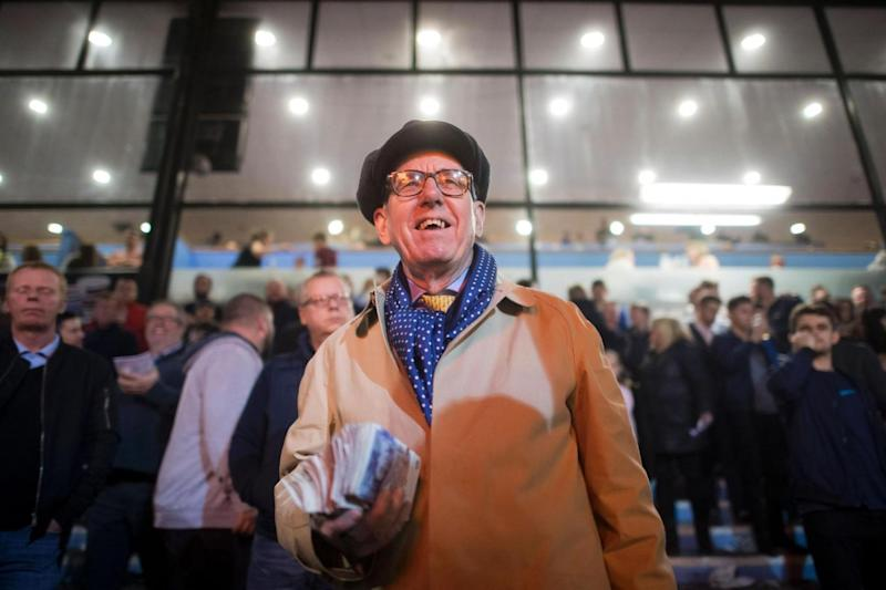 Part of the scenery: John Henwood, who has been a bookie at the track for more than 30 years (AFP/Getty Images)