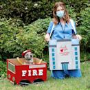 <p>Katherine Schwarzenegger and her pup Maverick honored essential workers on Tuesday by upcycling some Amazon Smile boxes to make Halloween boxtumes. </p>
