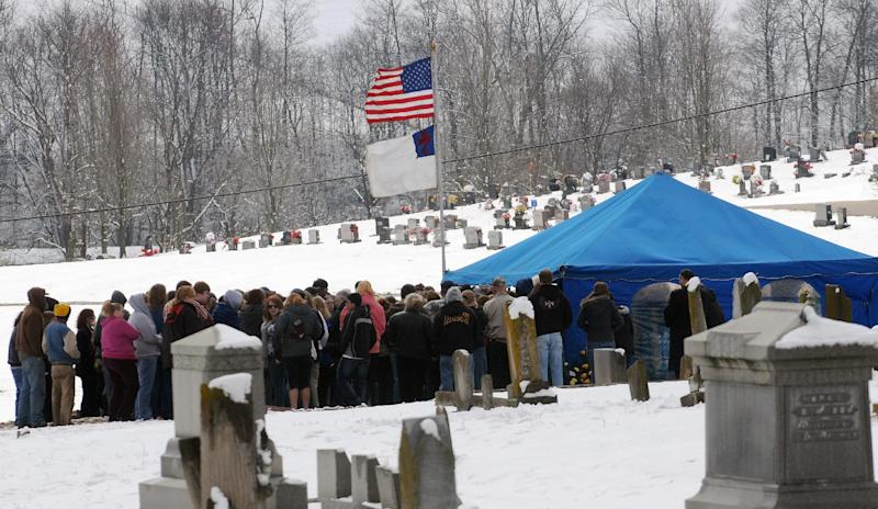 Friends and family gather for the funeral of the Brough family at Crown Hill Cemetery in Salem, Ind., Monday, March 5, 2012. An Indiana family including a toddler found in a field after violent tornadoes died Sunday after being taken off life support, ending a hopeful tale for survivors in the Midwest and South picking through the storms' devastation. (AP Photo/Stephen Lance Dennee)