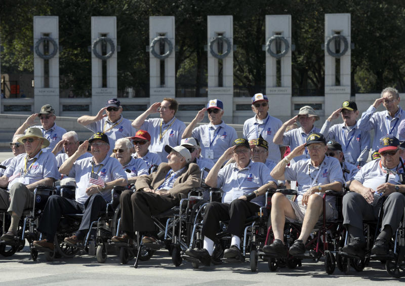 World War II veterans from the Chicago-area salute as they visit the World War II Memorial in Washington, Wednesday, Oct. 2, 2013. The group came to Washington on an honor flight despite the shutdown of the federal government. It was an act of civil disobedience that marked the fact some barriers nor a government shutdown would keep a group of World War II veterans from visiting the monument erected in their honor. (AP Photo/Susan Walsh)