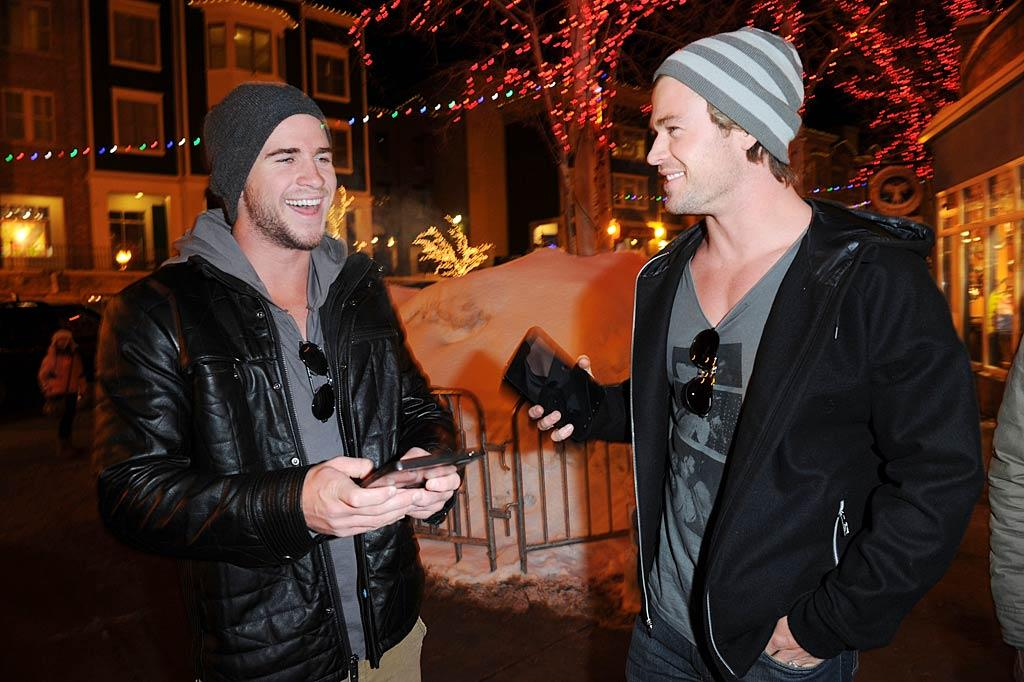 """Handsome Aussie actor brothers Liam and Chris Hemsworth shared a laugh after scoring some swag at the Samsung Galaxy Tab Lift on Saturday. Jason Merritt/<a href=""""http://www.wireimage.com"""" target=""""new"""">WireImage.com</a> - January 22, 2011"""
