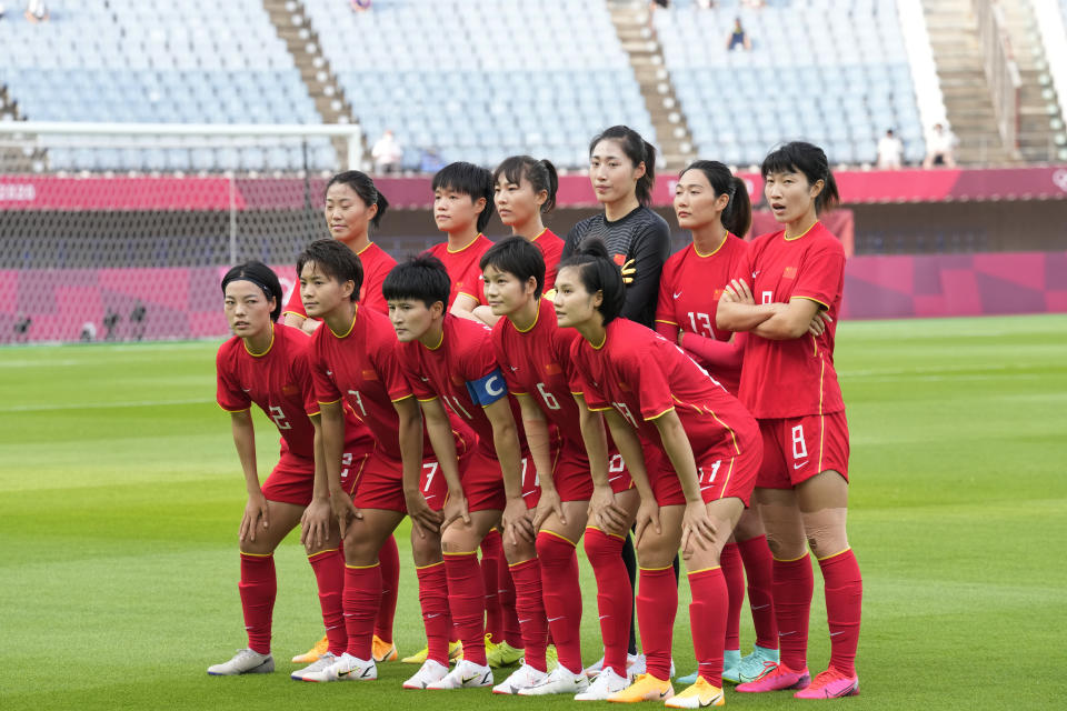 China players pose for a team photo prior to a women's soccer match against Brazil at the 2020 Summer Olympics, Wednesday, July 21, 2021, in Rifu, Japan. (AP Photo/Andre Penner)