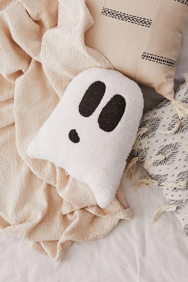 "<p>This soft fleece <a href=""https://www.popsugar.com/buy/Ghost-Sherpa-Pillow-471136?p_name=Ghost%20Sherpa%20Pillow&retailer=urbanoutfitters.com&pid=471136&price=34&evar1=casa%3Auk&evar9=46461771&evar98=https%3A%2F%2Fwww.popsugar.com%2Fhome%2Fphoto-gallery%2F46461771%2Fimage%2F46461773%2FGhost-Sherpa-Pillow&list1=pillows%2Challoween%2Challoween%20decor&prop13=api&pdata=1"" rel=""nofollow"" data-shoppable-link=""1"" target=""_blank"" class=""ga-track"" data-ga-category=""Related"" data-ga-label=""http://www.urbanoutfitters.com/shop/ghost-sherpa-pillow?category=halloween&amp;color=010"" data-ga-action=""In-Line Links"">Ghost Sherpa Pillow</a> ($34, originally $39) is so cute that you'll want to cuddle up with it all year round.</p>"
