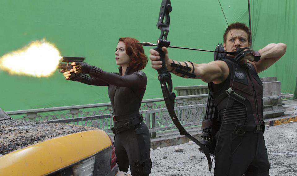 """In this film image released by Disney, Scarlett Johansson portraying Black Widow, left, and Jeremy Renner, portraying Hawkeye, are shown during the filming of Marvel's """"The Avengers."""" (AP Photo/Disney, Zade Rosenthal)"""