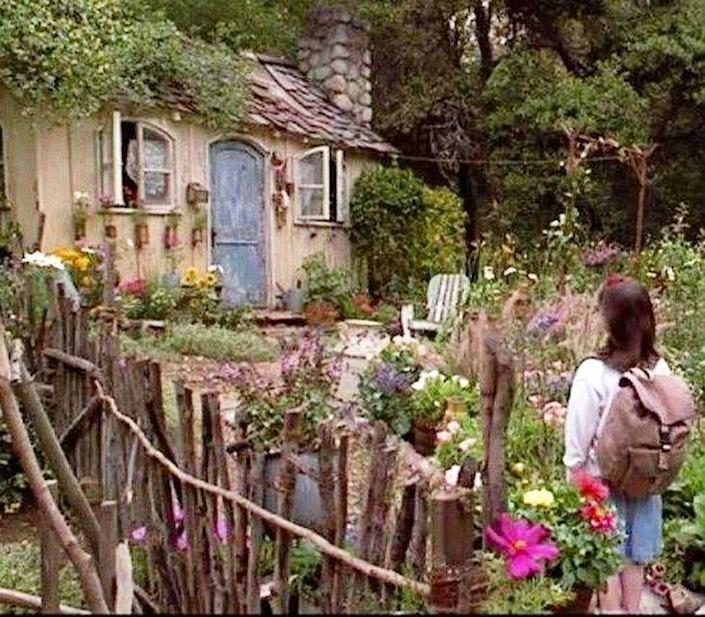 """<p>Long before cottagecore was a thing, Miss Honey's cottage in <em>Matilda</em> set the precedent for the enchanting aesthetic that has since captivated Pinterest boards and Instagram accounts alike. Despite its small size (or, in part, because of it), this cottage is described in a magical, other-wordly kind of way, as though Matilda is entering a new realm: """"It seemed so unreal and remote and fantastic and so totally away from this earth. It was like an illustration in Grimm or Hans Andersen. It was the house where the poor woodcutter lived with Hansel and Gretel and where Red Riding Hood's grandmother lived and it was also the house of The Seven Dwarfs and The Three Bears and all the rest of them. It was straight out of a fairy-tale."""" Roald Dahl also described this humble abode as being so tiny that """"it looked more like a doll's house than a human dwelling."""" </p><p>In the movie adaptation of the book, set director Rob Howell brought this imagery to life in the form of a tiny abode that looks straight out of a fairytale. </p>"""