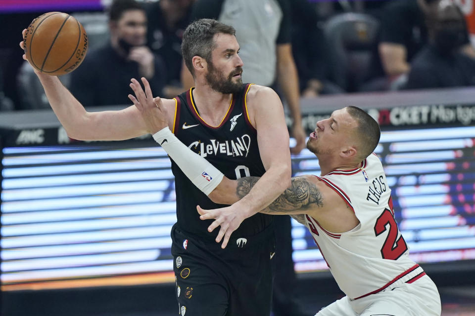 Chicago Bulls' Daniel Theis, right, defends against Cleveland Cavaliers' Kevin Love during the first half of an NBA basketball game Wednesday, April 21, 2021, in Cleveland. (AP Photo/Tony Dejak)