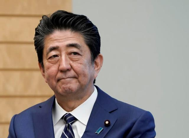 Japanese Prime Minister Shinzo Abe listens to IAEA Director General Rafael Grossi at the prime minister's official residence in Tokyo