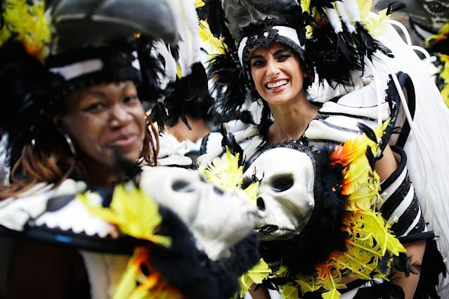 LONDON, ENGLAND - AUGUST 26: Members of the Paraiso Samba troupe prepare for the Notting Hill Carnival on August 26, 2013 in London, England. More than one million people are expected to enjoy this year's Notting Hill Carnival. It is the largest street festival in Europe and was first held in 1964 by the Afro-Caribbean community. Over the bank holiday weekend the streets come alive to steel bands, colourful floats and costumed performers as members of the public flood into the area to join in the celebrations. (Photo by Matthew Lloyd/Getty Images)