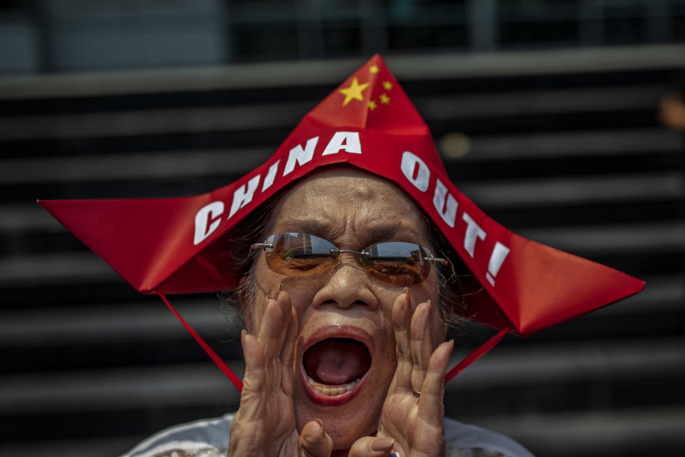 FILE PHOTO: A Filipino shouts slogans as he takes part in an anti-China protest outside the Chinese Embassy on July 12, 2019 in Makati, Metro Manila, Philippines. Protests marked the third anniversary of the Hague's Permanent Court of Arbitration decision on the West Philippine Sea, which in 2016 ruled in favor of the Philippines and rejected China's claims on the disputed waters. (Photo by Ezra Acayan/Getty Images)