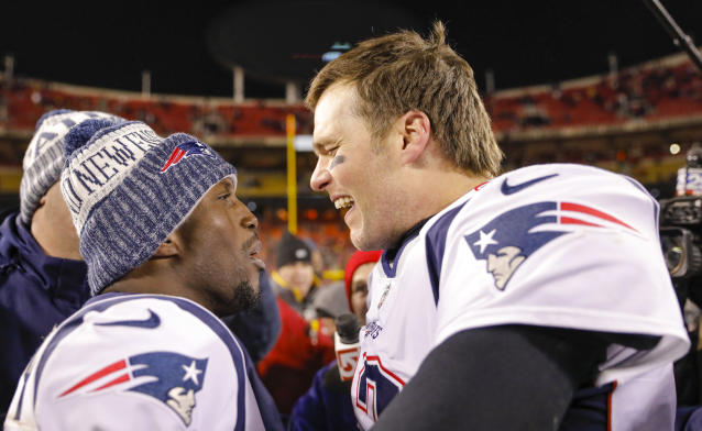Quarterback Tom Brady and safety Devin McCourty celebrate an AFC championship game win over the Chiefs. (Photo by David Eulitt/Getty Images)