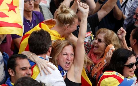 People celebrate the vote result in Barcelona - Credit: Reuters