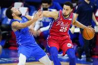 Philadelphia 76ers' Ben Simmons, right, dribbles past Dallas Mavericks' Jalen Brunson during the first half of an NBA basketball game, Thursday, Feb. 25, 2021, in Philadelphia. (AP Photo/Matt Slocum)