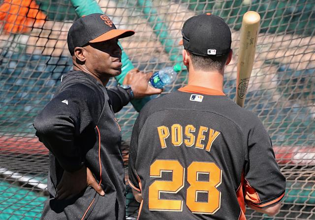 SCOTTSDALE, AZ - MARCH 10: Barry Bonds (L) of the San Francisco Giants speaks with Buster Posey #28 as a special hitting coach for one week of Spring Training during batting practice at Scottsdale Stadium on March 10, 2014 in Scottsdale, Arizona. (Photo by Christian Petersen/Getty Images)
