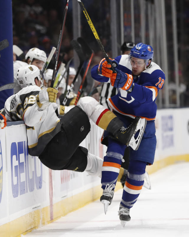 New York Islanders center Mathew Barzal (13) collides with Vegas Golden Knights left wing Tomas Nosek (92) during the second period of an NHL hockey game Thursday, Dec. 5, 2019, in Uniondale, N.Y. (AP Photo/Kathy Willens)