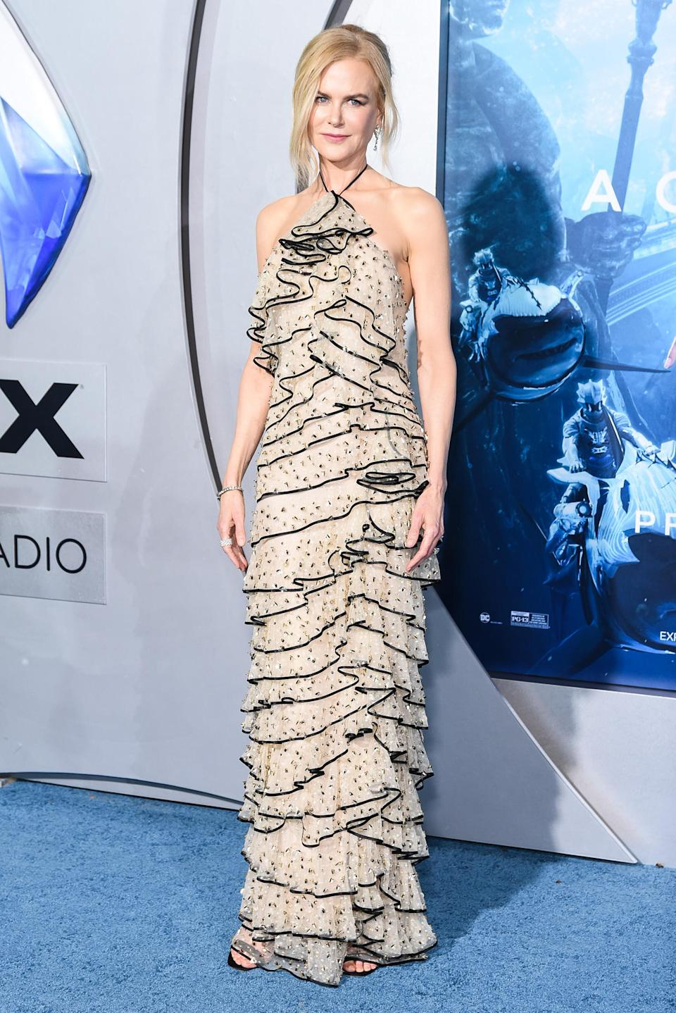 <p>The Aussie star bared her shoulders in a ruffled, halter neck gown at the premiere of her new film. <em>[Photo: Getty]</em> </p>