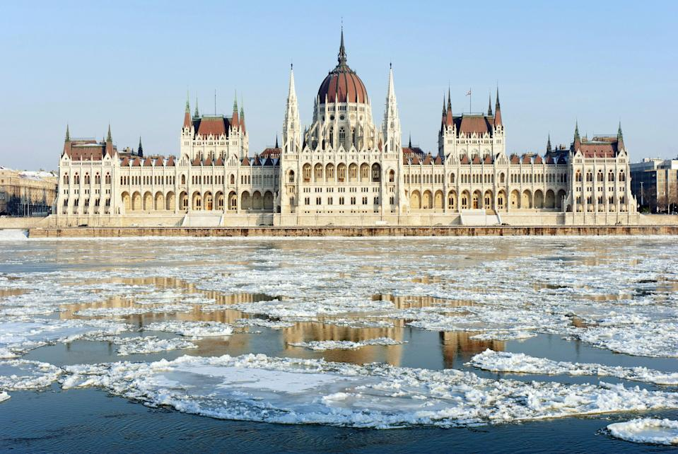 """Winter is, hands down, the best time to visit <a href=""""https://www.cntraveler.com/story/where-to-eat-stay-and-play-in-budapest?mbid=synd_yahoo_rss"""" rel=""""nofollow noopener"""" target=""""_blank"""" data-ylk=""""slk:Budapest"""" class=""""link rapid-noclick-resp"""">Budapest</a>. Seeing the Hungarian Parliament surrounded by ice drifts on the Danube could make even the strictest of beach bums embrace the cold. And you're sure to find all of those grand cafés, museums, and thermal baths infinitely more welcoming after spending a few chilly hours exploring the city."""