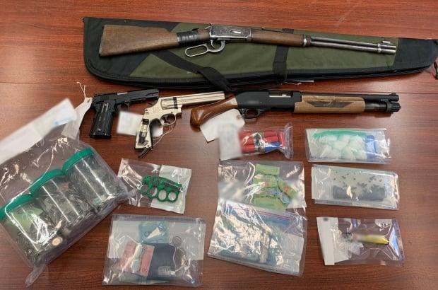 The seized items included  136 grams of crack cocaine, prescription drugs, two unsecured firearms, two pellet guns that replicate handguns, other weapons and drug trafficking paraphernalia.  ( RCMP  - image credit)