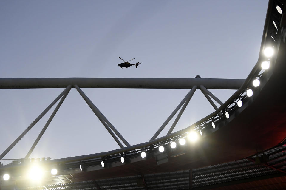 A police helicopter flies above the Emirates stadium during the English Premier League soccer match between Arsenal and Everton in London, Friday, Apr 23, 2021. (Michael Regan/Pool via AP)