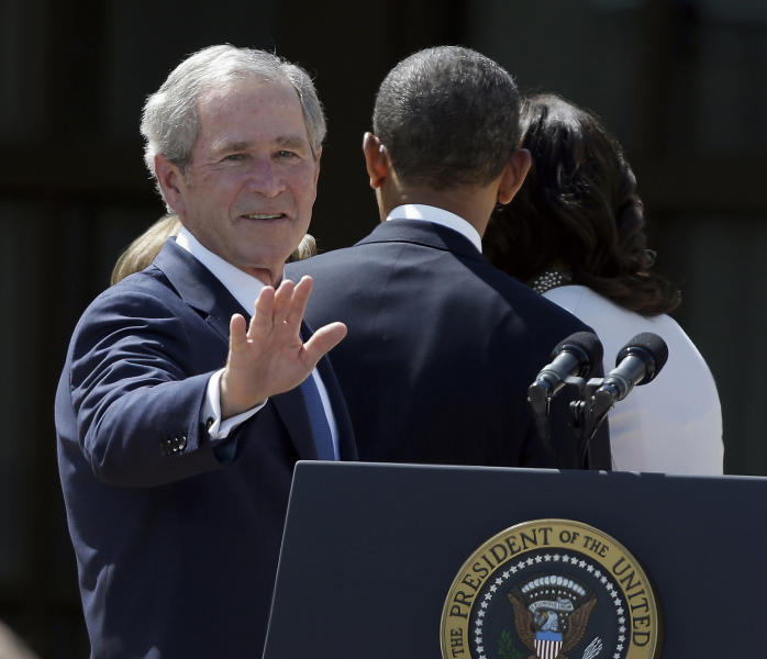 FILE – In this April 25, 2013, file photo former President George W. Bush turns to wave as he leaves with President Barack Obama and first lady Michelle Obama after the dedication of the George W. Bush Presidential Center in Dallas. Bush has successfully undergone a heart procedure after doctors discovered a blockage in an artery. (AP Photo/LM Otero, File)