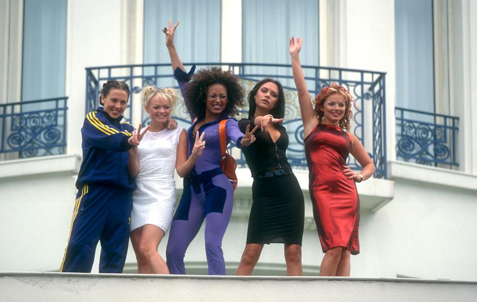 CANNES, FRANCE - MAY 11:  Pop group Spice Girls: Sporty Spice Melanie Chisholm, Baby Spice Emma Bunton, Scary Spice Melanie Brown, Posh Spice Victoria Adams and Ginger Spice Geri Halliwell pose outside the Martinez Hotel in Cannes, during the 50th Cannes Film Festival, to promote their new movie 'Spice the Movie' which will be filmed in London in June on May 11, 1997 in Cannes, France. (Photo by Ron Davis/Getty Images)