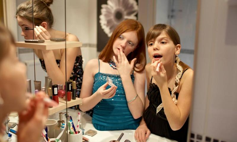 Girls applying makeup.