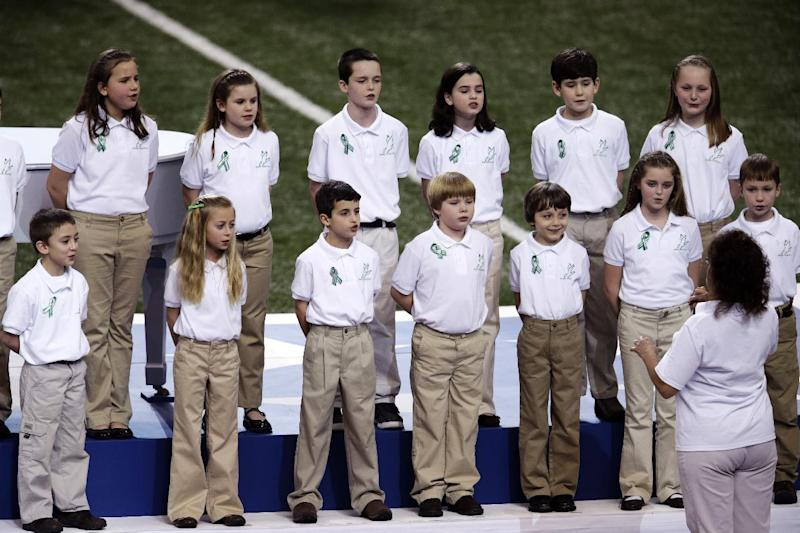 """Students from Sandy Hook Elementary School sing """"America the Beautiful"""" before the NFL Super Bowl XLVII football game between the San Francisco 49ers and the Baltimore Ravens, Sunday, Feb. 3, 2013, in New Orleans. (AP Photo/Charlie Riedel)"""