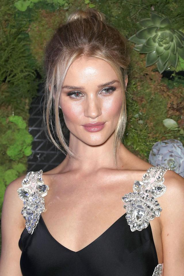 """<p>Like <a rel=""""nofollow"""" href=""""https://www.harpersbazaar.com/uk/beauty/hair/g20002256/meghan-markles-beauty-transformation/"""">Meghan, the Duchess of Sussex</a>, Rosie Huntington-Whiteley knows that the secret to making a messy bun look effortless chic is to assessorise it with face-framing tendrils. To recreate the look, use Toni & Guy's <a rel=""""nofollow"""" href=""""https://store.toniandguy.com/product/61/toniandguy-standard-tail-comb?gclid=CjwKCAjwns_bBRBCEiwA7AVGHsZI9NlN1Lcu6GJp9Ycz1KB08QDl0V8T-OH4xumSZdyrn759lE6WYRoC7awQAvD_BwE"""">Tail Comb</a>, £2.40, to separate out a few strands at your hair line you want to leave out and bend these over Ghd's <a rel=""""nofollow"""" href=""""https://www.ghdhair.com/wands/ghd-curve-classic-wave-wand"""">Curve Wand</a>, £120, to shape them round your face. Then, add texture  to your hair using Hair by Sam McKnight's <a rel=""""nofollow"""" href=""""https://www.cultbeauty.co.uk/hair-by-sam-mcknight-cool-girl.html?gclid=CjwKCAjwns_bBRBCEiwA7AVGHkbs7y0Bja_Cp_jzG7ACYDexHpJIHZmdS3bIhQInL2uAgj-rzlnpfhoCX-sQAvD_BwE&ef_id=WszTdAAAAvpSTBN_:20180815094434:s"""">Cool Girl Spray</a>, £25, before creating your bun and spritzing on L'Oreal's <a rel=""""nofollow"""" href=""""https://www.amazon.co.uk/LOreal-Elnett-Supreme-Hairspray-400ml/dp/B003P4W68W/ref=sr_1_2_sspa?s=beauty&ie=UTF8&qid=1521023162&sr=1-2-spons&keywords=L%27Oreal%27s+Elnett+Hairspray&psc=1"""">Elnett Hairspray</a>, £5, to finish.</p><p></p>"""